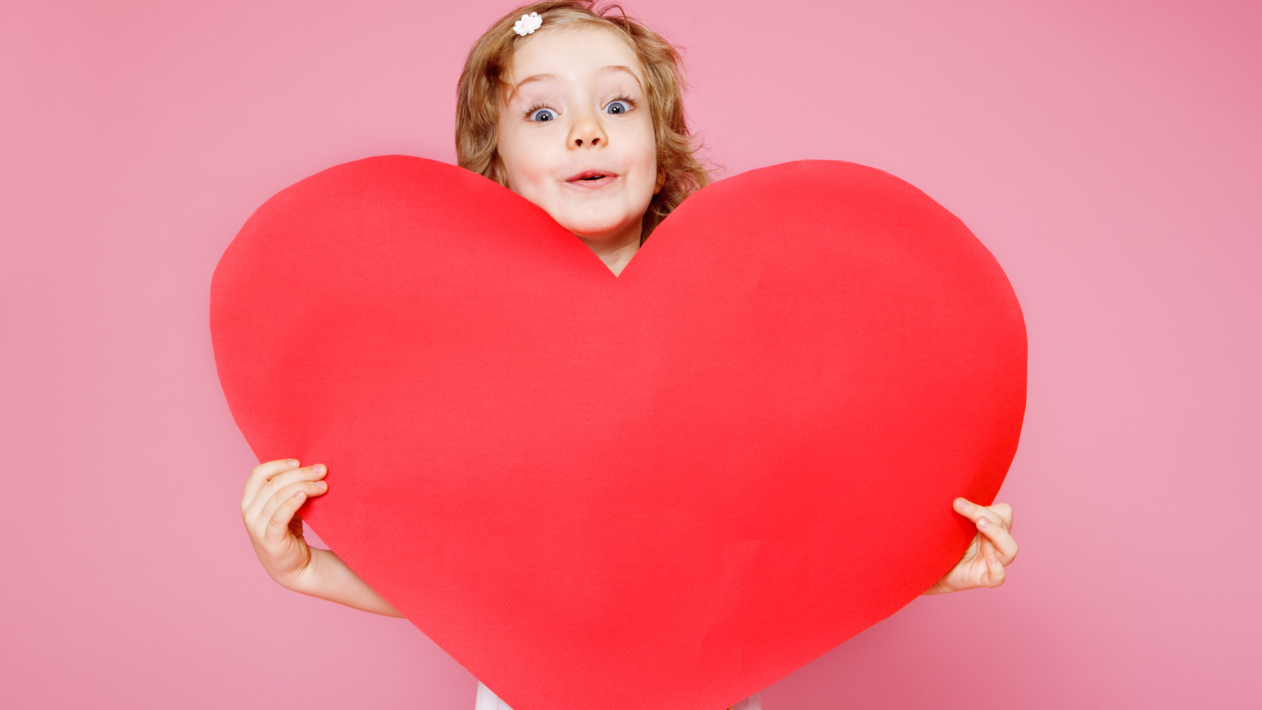 Child holding a large heart
