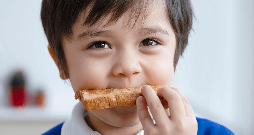 Child eating toast