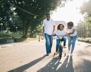 parents and child on bike